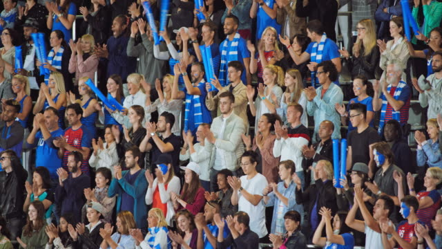 spectators at the stadium applauding at the end of the national anthem - face paint stock videos & royalty-free footage
