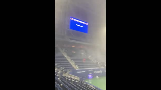 spectators at the us open were soaked as rain poured through the retractable roof at the louis armstrong stadium in corona, queens, on september 1.... - https stock-videos und b-roll-filmmaterial