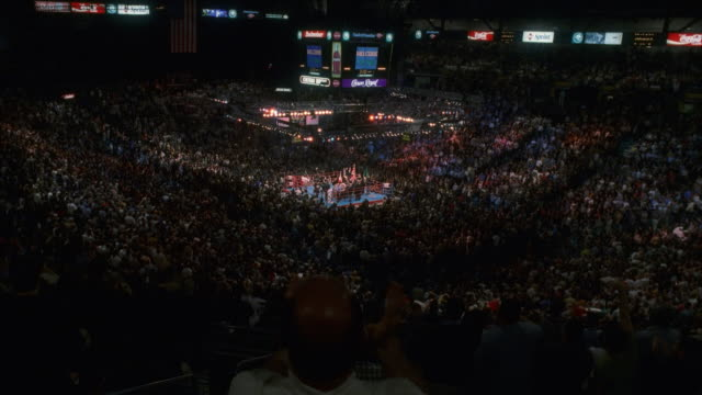 shaky, ha, ws spectators cheering on boxing match - boxing ring stock videos & royalty-free footage