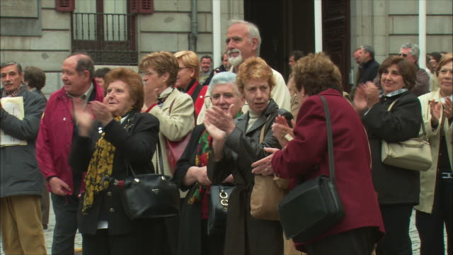 ms spectators clapping hands, madrid, spain - tre quarti video stock e b–roll