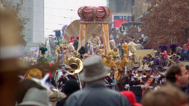 spectators enjoy a new orleans mardi gras parade - gras stock videos and b-roll footage