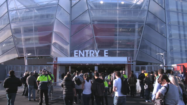 ms spectators enter eden park stadium to attend rugby game / auckland, new zealand - entrance sign stock videos & royalty-free footage