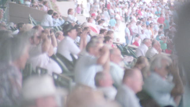 spectators fill the grandstands at a racetrack. - horse racing stock videos & royalty-free footage