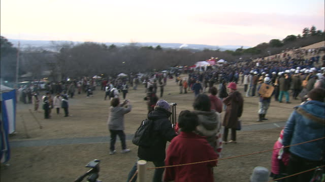 spectators gather at mount wakakusa. - shinto stock videos and b-roll footage