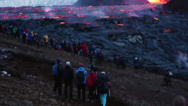spectators gather on the hillside to watch the volcano erupt as the sun sets on march 28, 2021 on the reykjanes peninsula, iceland. the mount... - iceland stock videos & royalty-free footage