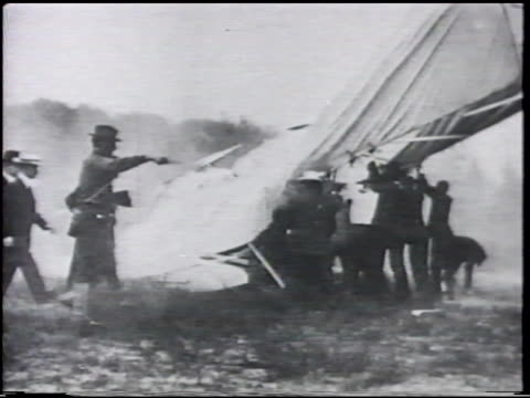 spectators helping lift crashed 'wright flyer' biplane aircraft up. us army signal corps lt. thomas selfridge dead body being carried on stretcher.... - air vehicle stock videos & royalty-free footage
