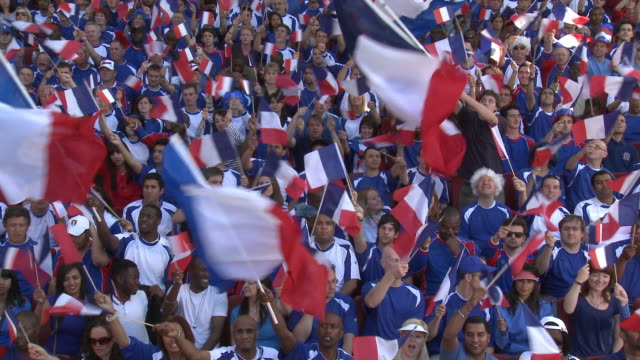 ws spectators in bleachers cheering and waving french flags, london, uk - french flag stock videos and b-roll footage