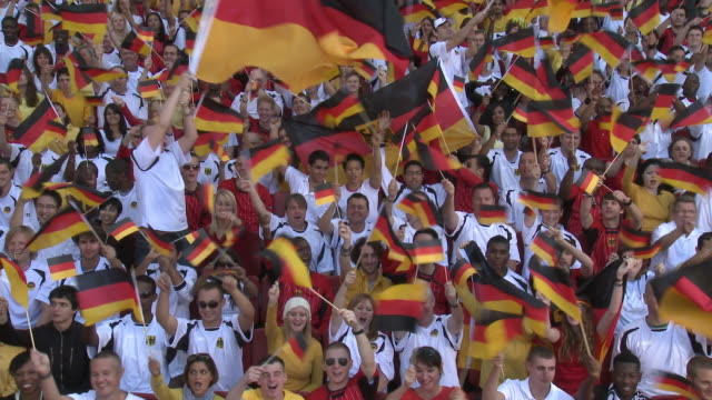 ws spectators in bleachers cheering and waving german flags, london, uk - anhänger stock-videos und b-roll-filmmaterial