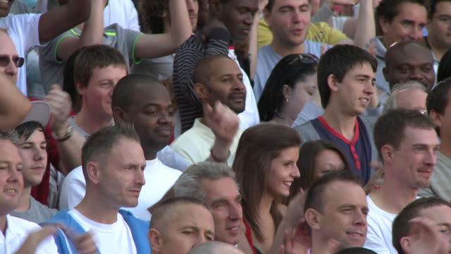 ms pan spectators in bleachers cheering, london, uk - encouragement stock videos & royalty-free footage