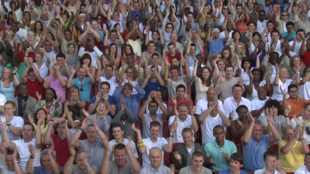 ws spectators in bleachers clapping and cheering, london, uk - applaudire video stock e b–roll