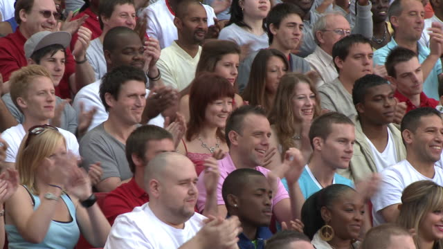 ms td spectators in bleachers clapping hands, london, uk - mid adult men stock videos & royalty-free footage
