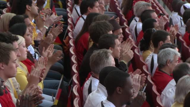 MS PAN Spectators in bleachers clapping hands, London, UK