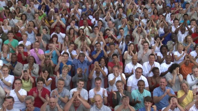 ws spectators in bleachers clapping hands, london, uk - applaudieren stock-videos und b-roll-filmmaterial