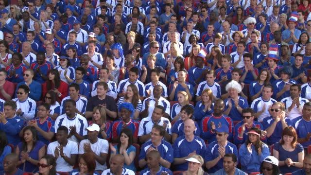 ws spectators in bleachers clapping hands, london, uk - bleachers stock videos & royalty-free footage
