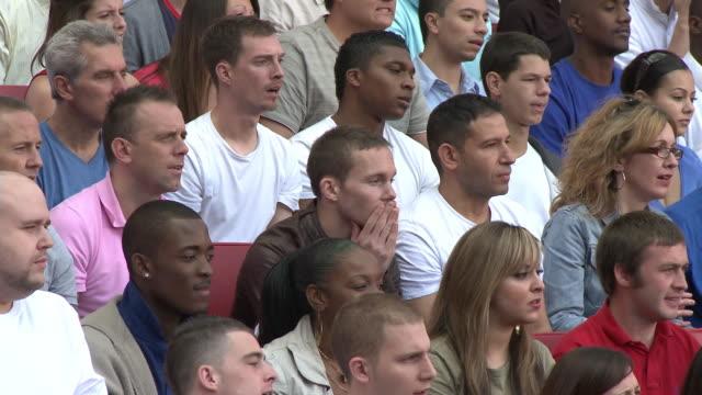 ms pan spectators in bleachers reacting to missed shot, london, uk - fan enthusiast stock videos & royalty-free footage