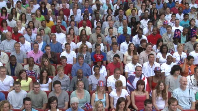 WS Spectators in bleachers reacting to missed shot, London, UK