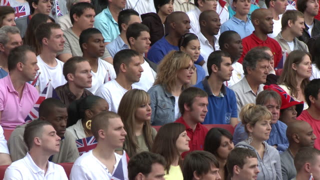 ms spectators in bleachers turning heads and waving british flags, london, uk - sideways glance stock videos & royalty-free footage