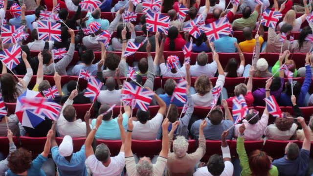 WS HA Spectators in bleachers waving British flags, London, UK