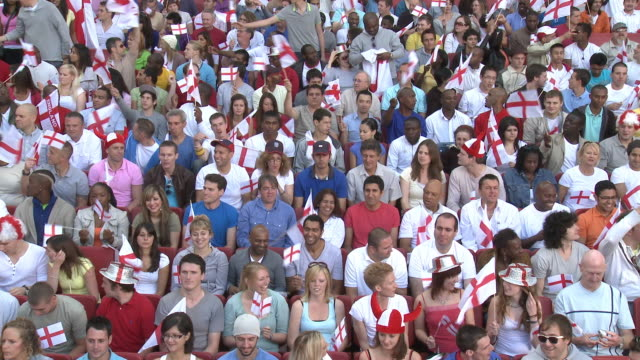 ws spectators in bleachers waving english flags, london, uk - english culture stock videos & royalty-free footage