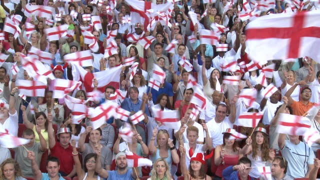 ws spectators in bleachers waving english flags, london, uk - england stock videos & royalty-free footage