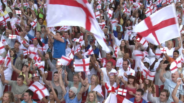 WS Spectators in bleachers waving English flags, London, UK
