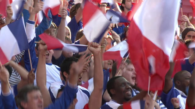 ms spectators in bleachers waving french flags, london, uk - french culture stock videos & royalty-free footage