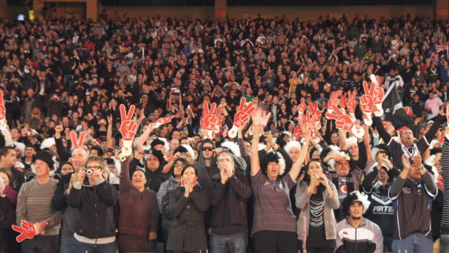 MS Spectators inside Eden Park Stadium clapping cheering and waving / Auckland, New Zealand