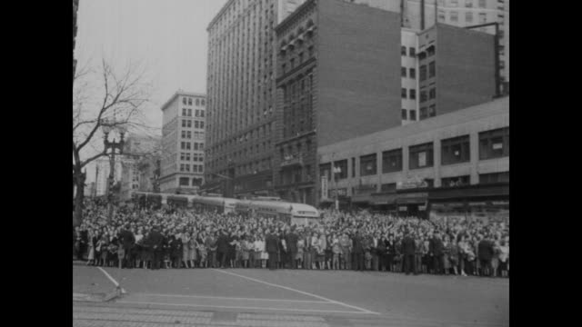 stockvideo's en b-roll-footage met spectators line the streets and climb trees during a motorcade to celebrate truman's election in washington d.c. - 1948