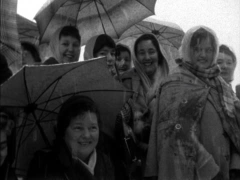 Spectators stand around in blizzard conditions to watch the wedding of Lady Pamela Mountbatten to David Hicks at Romsey Abbey 1960