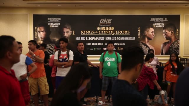 Kings Conquerors event at the Venetian Macao in Macau on Saturday Aug 5 Spectators walk past an advertisement for The One Kings Conquerors event...