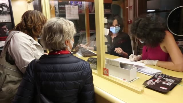 spectators wait to collect their tickets at teatro menotti's box office, before the first show after three months of lockdown on june 15, 2020 in... - spettacolo teatrale video stock e b–roll