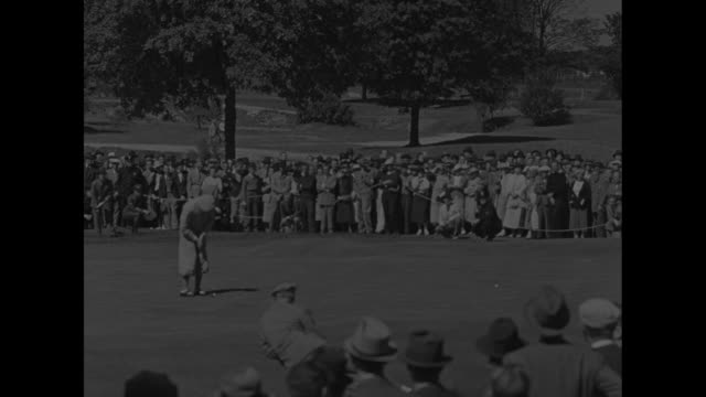 spectators walk toward camera across the green / us golfer johnny fischer, surrounding spectators applaud / scottish golfer jock mclean putts, crowd... - amateur stock videos & royalty-free footage