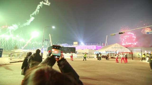 spectators watch a fireworks display during the opening ceremony of the 2018 pyeongchang winter olympic games outside the main stadium in the... - opening ceremony stock videos & royalty-free footage