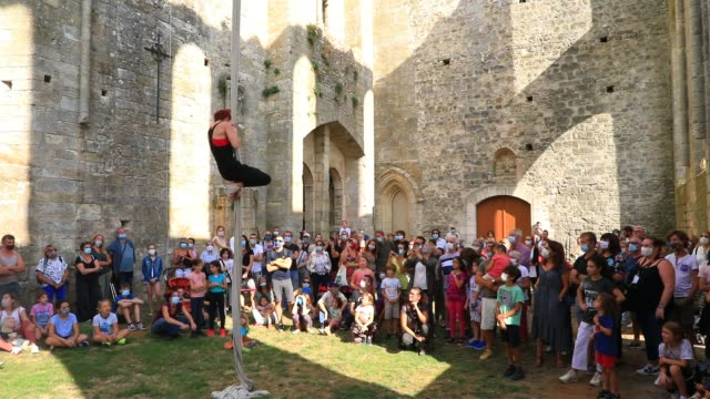 """spectators watch a member of the """"in fine"""" aerial dance company climbing a rope in ruined nave of the """"saint-mathurin church on september 20, 2020 in... - modern dancing stock videos & royalty-free footage"""