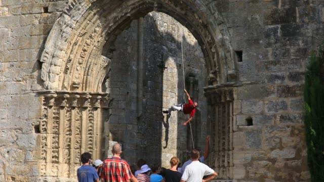 """spectators watch a member of the """"in fine"""" aerial dance company perform a choreography on the walls on the ruined nave of the """"saint-mathurin church... - modern dancing stock videos & royalty-free footage"""