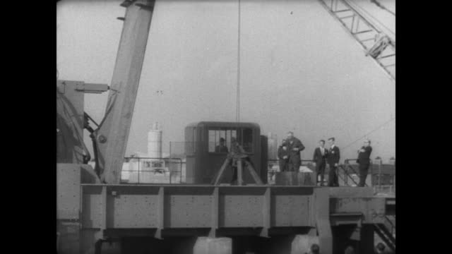 spectators watch as england's new fragmentation plant crushes scrap metal / claw wrapped around an old car / car falls into the machine which spits... - 1967 stock videos & royalty-free footage
