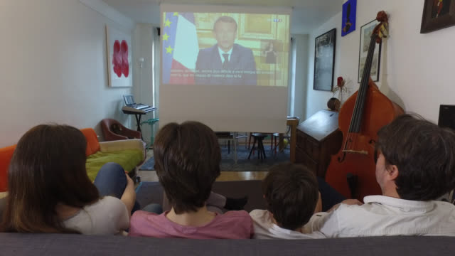 spectators watch as french president emmanuel macron speaks from the elysee palace during a televised address to the nation on the 28th day of a... - family with two children stock videos & royalty-free footage