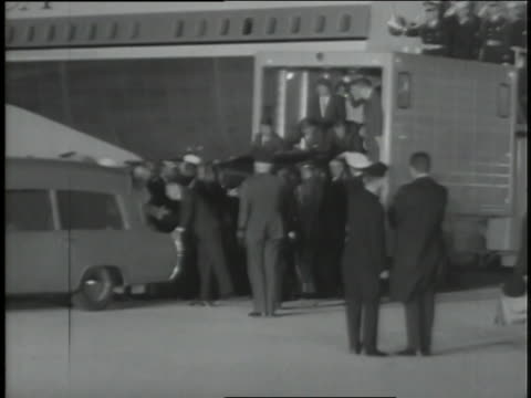 spectators watch as president kennedy's coffin is moved from air force one to a waiting hearse. - john f. kennedy us president stock videos & royalty-free footage