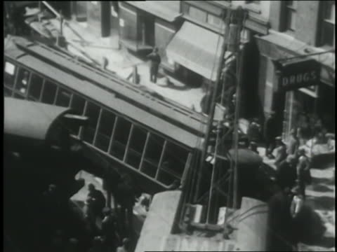 spectators watch as workers clean up the wreckage from where a trolley jumped the tracks. - newsreel stock videos & royalty-free footage