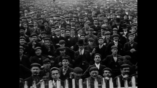 vidéos et rushes de 1902 spectators watch sheffield united take on bury at bramall lane - angleterre
