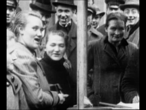 spectators watch soldier at his food cart / customers at the cart / french soldiers at mobile soup kitchen serve citizens in duisburg / woman takes... - 1920 stock-videos und b-roll-filmmaterial