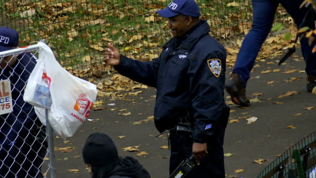Spectators watch the annual NYC Marathon from the 59th Street Columbus Circle and Central Park vicinity in Manhattan Note New York Police Department...