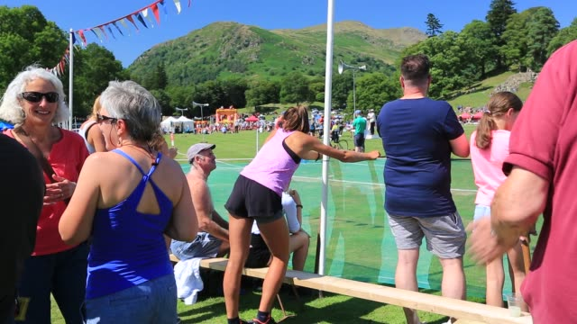 spectators watching events, whilst woman stretches at the annual ambleside sports event, ambleside, lake district, united kingdom. - stretching stock videos & royalty-free footage