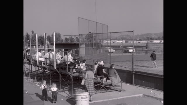 ws pan spectators watching little league baseball match from stands / united states - youth baseball and softball league stock videos and b-roll footage