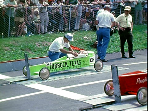 spectators watching race heads turning with passing race cars allamerican soap box derby at derby downs / slow motion of judge waving starting flag /... - c119gs stock videos & royalty-free footage