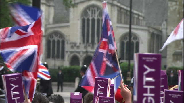 spectators wave flags near westminster abbey in london, england. - union jack stock videos & royalty-free footage