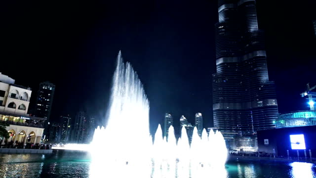specular burj khalifa's fountain at night - fountain stock videos and b-roll footage