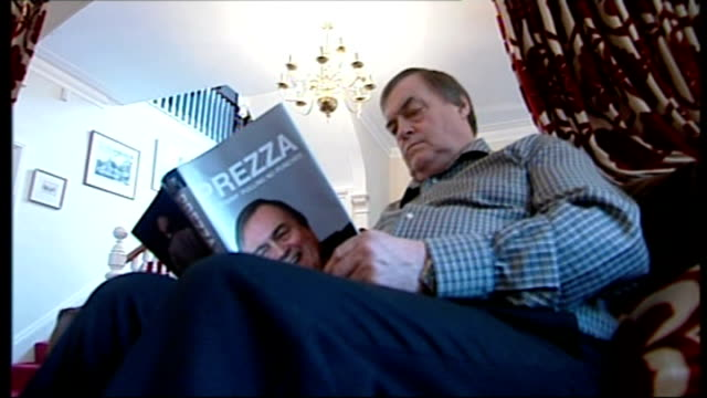 stockvideo's en b-roll-footage met speculation over gordon brown future continues lib hull int setup shots of john prescott sitting at home looking at his autobiography 'prezza' - autobiografie