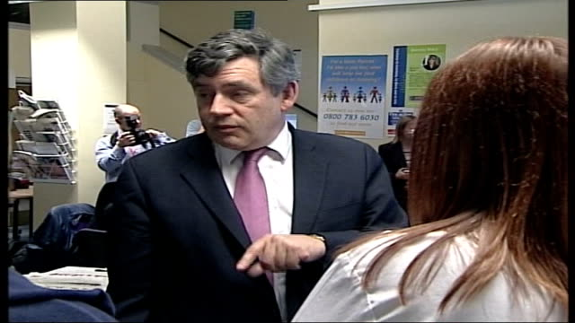 Speculation over race to succeed Blair POOL Gordon Brown MP standing speaking with others on visit LIB EXT Prescott along in park playing football...