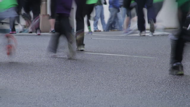 sped up close up of feet running down street